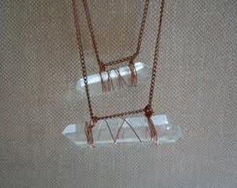 Horizontally wire wrapped crystal pendent.
