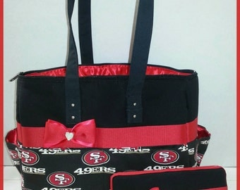 49ers diaper bag with matching wipe case. Bow. Red and black.