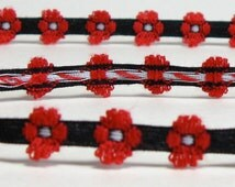 Black, Red, and White Woven Floral Trim