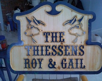 Carved outdoor home or business signs