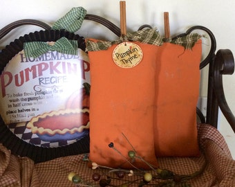 Set of two primitive pumpkin shelf sitters
