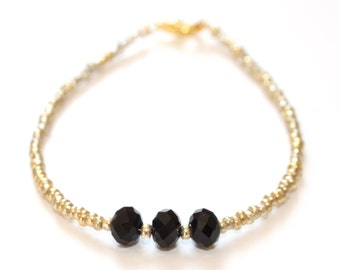 Handmade gold bead bracelet with black glass crystal rondelle beads