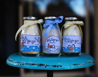 Milk bottles. Cute soy candles in old fashioned milk bottles with lids.