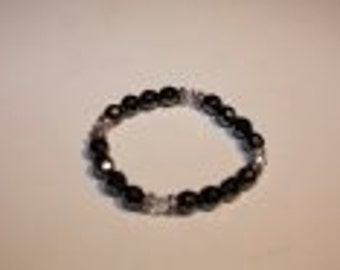 Strech bracelet with black hematiet colored beats.