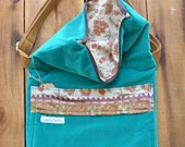 Smitha. Large fold over crossbody messenger with front pocket. Adjustable strap and size.
