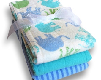 Small Prefold Cloth Diapers. Reusable Cotton Flannel Baby Diapers. Blue Burp Cloths. Changing Pads. Trifold Soaker Inserts. Trifold Boosters