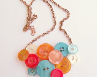 Button necklace in orange, blue, red and white