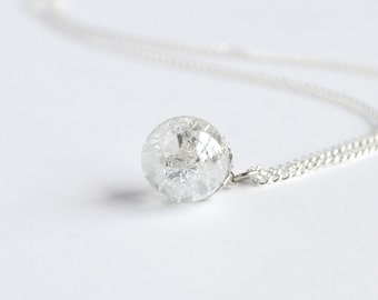 Clear ice shattered glass marble necklace on delicate silver chain