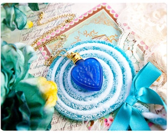 my devils heart is winter frosted blue on chain - natural perfume oil held captive within a frosted heart of glass - over 60+ aroma options