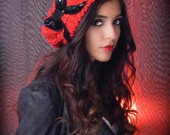 Knitted beret hat with a black beaded/sequin bow