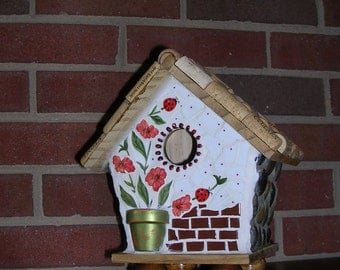 Decorative Bird house, stone, potted plants, lady bugs