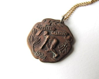 "Antique Running Medal / ""Catholic School 1924"""