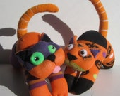 JINX and JAX are a pair of child safe Bewitchin' Halloween kitt'ins made from repurposed socks.