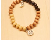 Stretch Beaded Bracelet - Day and Night Charms with Wood Beads