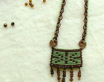Forest green micro macrame necklace on hand forged copper spirals