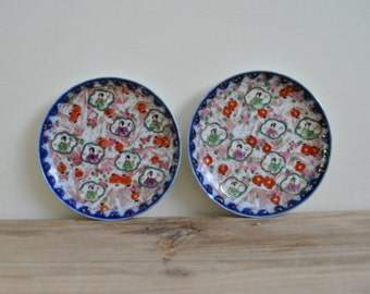 Vintage pair of hand painted Oriental small side plates