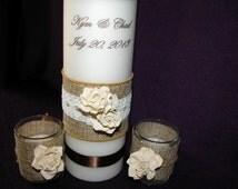 Rustic votive holder embellished with burlap and ivory rose.