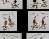 Silver Horse earrings with different colored beads.