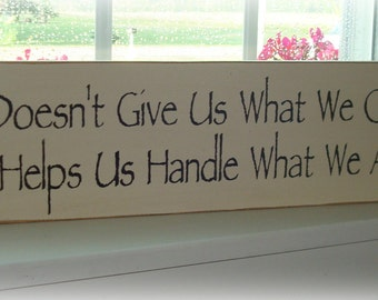 God doesn't give us what we can handle. He helps us handle what we are given wood sign  board