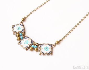 Necklace with Scandinavian pattern tile earrings. Nordic flowers. Blue, white, golden.