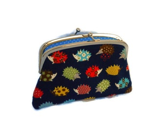 Navy Hedgehog two compartments coin purse with kiss lock divider and turquoise fabric interior, bright patterned hogs