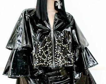 ADELE PSYCH  'Arachne' Glam Goth Rock Metal style Black Shiny PVC Cropped Jacket with Ruffle Sleeves and Studded Cobweb detail
