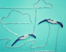 """Albatross necklace. Handmade bird necklace, high gloss finish with optional heart detail, hangs from a faux silver 19"""" chain."""