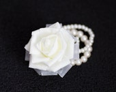 Wrist corsage simple cream ivory rose on a pearl bracelet with ribbons, perfect weddings corsage or prom corsage