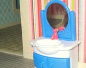 Miniature dollhouse blue and white plastic bathroom sink