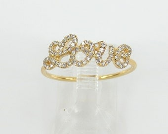 "18k Yellow gold & 0.20cts Diamond Pave ""Love"" Ring band."