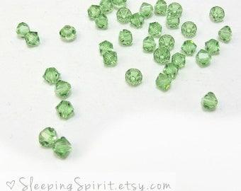 Swarovski Crystal Bicones, 24 Peridot Green Genuine Swarovski Crystal 4mm Bicones, Item 153B