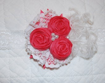 Coral rosette Headband by Caprice Colette