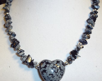 Snowflake obsidian heart necklace.