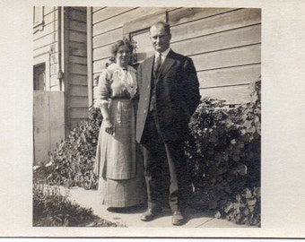 Antique RPPC of Man and Woman Outside of Home