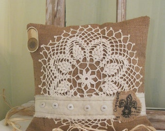 Rustic vintage inspired Burlap pillow with crochet Doily Linen, printed burlap trim and buttons