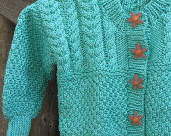 Hand knit Starfish Sweater for a Special Baby