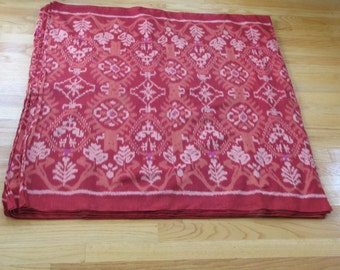 Hand woven cotton red and peach ikat fabric by the yard