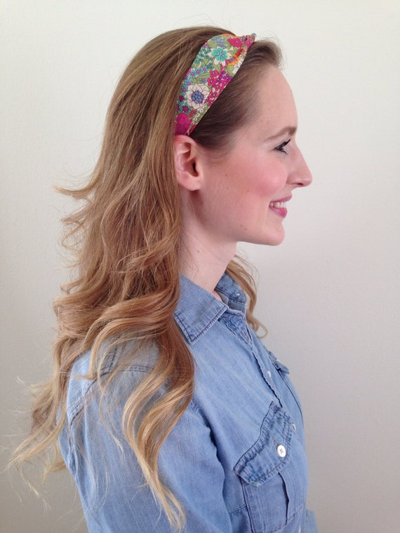 Headband in bright floral print in greens and pinks with cotton grosgrain ribbon trim and elastic closure
