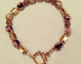 Sale- gorgeous gold plated bracelet with hand painted beads