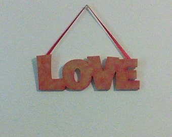 "Red and Gold ""love"" sign"