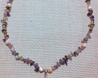 tranquility: beaded matinee necklace featuring amethyst, peridot and mother of pearl beads. amethyst pendant