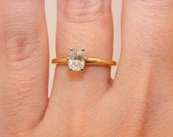0.63 Carat oval cut diamond engagement ring. 14K yellow gold. Clarity I1