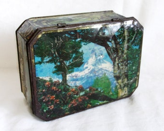 Rusty Mountain. Vintage tin box. Shabby, weathered tinplate. Forest woodland nature scenery. Trekking, hunting cabin. Rustic home decor