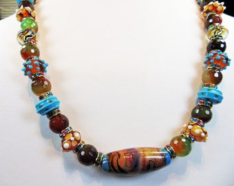 Flight of fancy -- a rainbow of colored lampwork beads