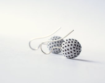 globe earrings white black dots