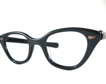 SALE black plastic cat eye glasses. horn rimmed frames. no lenses new old stock/NOS/deadstock. thick browline eyeglasses.