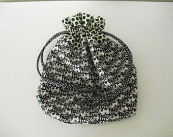 Black and white lined drawstring bag