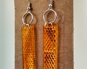 Pedal reflector earrings keep you safe AND looking amazing!