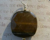 Faceted tigers eye stone, with gold beads and sterling bail