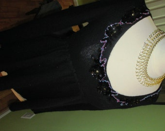 What a FUN and FUNKY Free People Embellished Sweater with Peek a boo Back